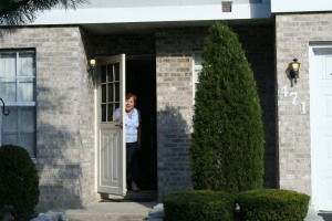 Mom welcoming us at the door of her townhouse.